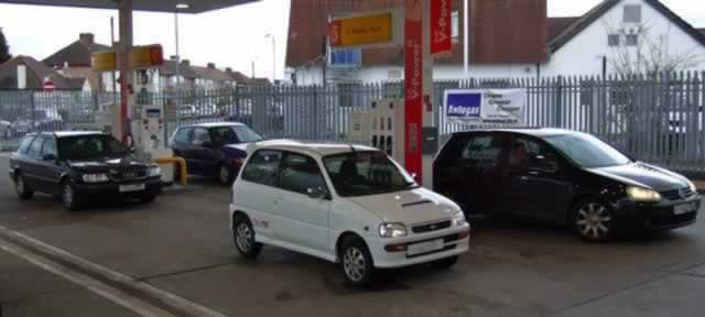 Daihatsu Cuore Avanzato at the pumps
