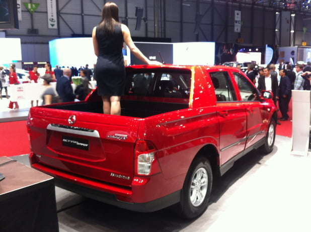Girl in the back of a SsangYong Actyon Sports pick-up