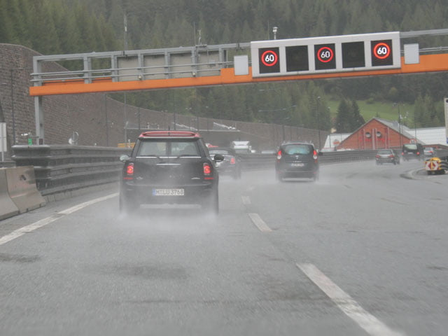 MINI John Cooper Works Clubman on a rain-drenched motorway, Italy