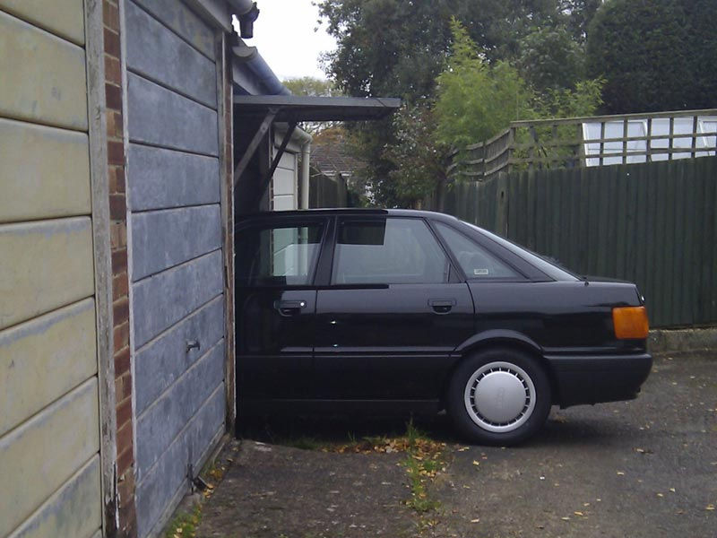 Audi 80 emerges from garage