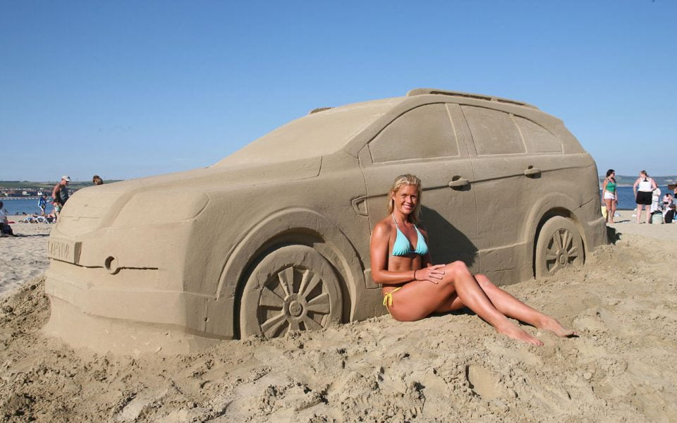 Chevrolet sand castle and bikini girl