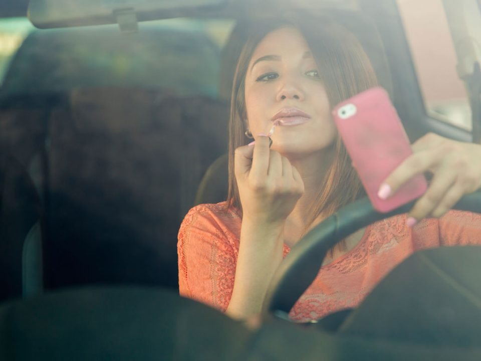 Girl using phone while driving