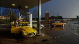 Citroen 2CV and Peugeot 505 at petrol station
