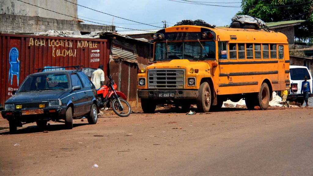 Nissan March and school bus