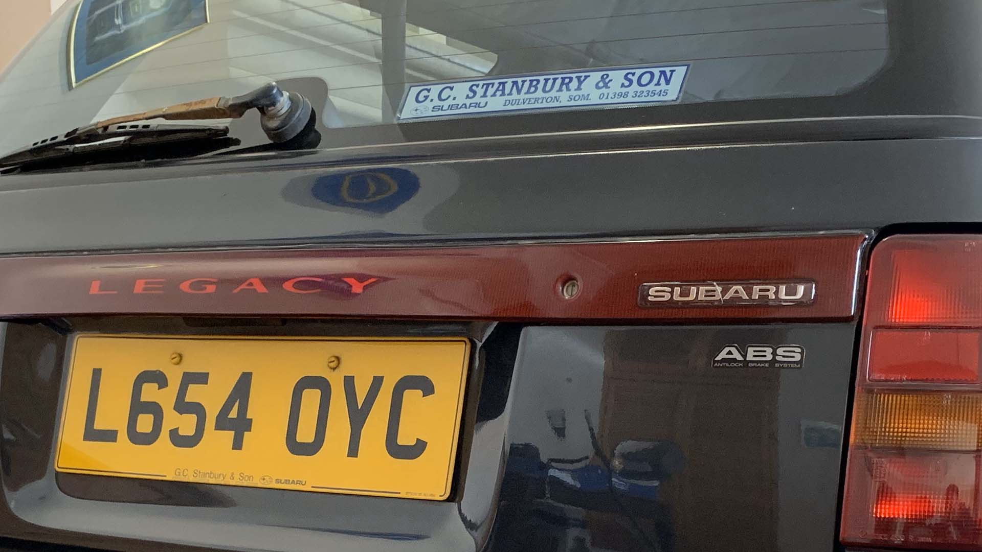 GC Stanbury car dealer sticker and plate